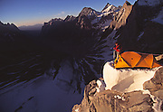 "The late American mountaineer Alex Lowe coils a rope during an ascent of ""The Bird"" a peak in the Ak Su region of the Pamir Atlai Mountains, Kyrgyzstan."