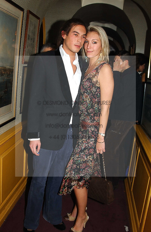 IAIN RUSSELL and MISS OLIVIA BUCKINGHAM at a private dinner and presentation of Issa's Autumn-Winter 2005-2006 collection held at Annabel's, 44 Berkeley Square, London on 15th March 2005.<br />