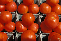 close up fresh produce market stand vegetable red tomato tomatoe baskets box