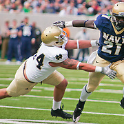 Navy RB (#21) Gee Gee Greene demonstrates why Navy is 5-2 as Greene stiff arm his way Pass Senior Offensive Tackle (#74) Christian Lombard for the Touchdown. Navy defeats Notre Dame 35-17 at The New Giant's Stadium in East Rutherford New Jersey