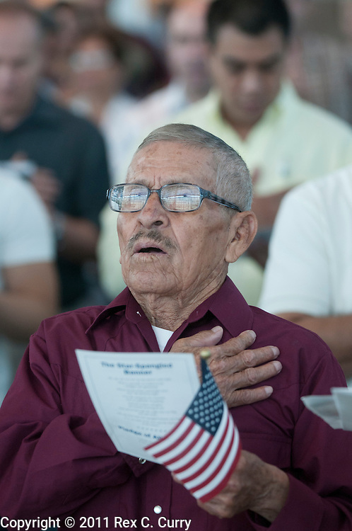"""Francisco Almanza Perez sings along to """"God Bless America"""" during a naturalization ceremony at the U.S. Citizenship and Immigration office in Irving on June 30, 2011."""