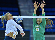 December 3, 2016; Los Angeles, Calif.; UCLA Bruins outside hitter Jordan Anderson swings across her body to send a shot down the line against Baylor Bears outside hitter Ashley Fritcher in the first set during the second round match of the 2016 Division I NCAA Volleyball Championship tournament at Pauley Pavilion.