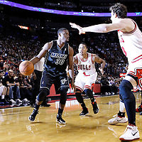 29 January 2012: Chicago Bulls center Omer Asik (3) and Chicago Bulls point guard Derrick Rose (1) defend on Miami Heat point guard Norris Cole (30) during the Miami Heat 97-93 victory over the Chicago Bulls at the AmericanAirlines Arena, Miami, Florida, USA.
