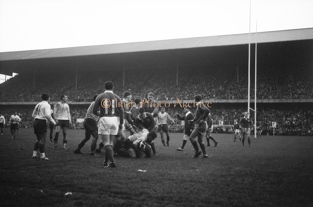 Irish Rugby Football Union, Ireland v France, Five Nations, Landsdowne Road, Dublin, Ireland, Saturday 23rd January, 1965,.23.1.1965, 1.23.1965,..Referee- D G Walters, Welsh Rugby Union, ..Score- Ireland 3 - 3 France, ..Irish Team, ..T J Kiernan,  Wearing number 15 Irish jersey, Full Back, Cork Constitution Rugby Football Club, Cork, Ireland,..P J Casey, Wearing number 14 Irish jersey, Right Wing, Landsdowne Rugby Football Club, Dublin, Ireland, ..J C Walsh,  Wearing number 13 Irish jersey, Right Centre, University college Cork Rugby Football Club, Cork, Ireland,..M K Flynn, Wearing number 12 Irish jersey, Left Centre, Wanderers Rugby Football Club, Dublin, Ireland, ..K J Houston, Wearing number 11 Irish jersey, Left Wing, Bruff Rugby Football Club, Limerick, Ireland, and, Oxford University Rugby Footabll Club, Oxford, England, ..C M H Gibson, Wearing number 10 Irish jersey, Stand Off, Cambridge University Rugby Football Club, Cambridge, England, and, N.I.F.C, Rugby Football Club, Belfast, Northern Ireland, ..R M Young, Wearing number 9 Irish jersey, Scrum Half, Queens University Rugby Football Club, Belfast, Northern Ireland,..S MacHale, Wearing number 1 Irish jersey, Forward, Landsdowne Rugby Football Club, Dublin, Ireland, ..K W Kennedy, Wearing number 2 Irish jersey, Forward, Queens University Rugby Football Club, Belfast, Northern Ireland,..R J McLoughlin, Wearing number 3 Irish jersey, Captain of the Irish team, Forward, Gosforth Rugby Football Club, Newcastle, England, ..W J McBride, Wearing number 4 Irish jersey, Forward, Ballymena Rugby Football Club, Antrim, Northern Ireland,..W A Mulcahy, Wearing number 5 Irish jersey, Forward, Bective Rangers Rugby Football Club, Dublin, Ireland, ..M G Doyle, Wearing number 6 Irish jersey, Forward, University College Dublin Rugby Football Club, Dublin, Ireland,..R A Lamont, Wearing number 8 Irish jersey, Forward, Instonians Rugby Football Club, Belfast, Northern Ireland, ..N Murphy, Wearing number 7 Irish jersey, Forward