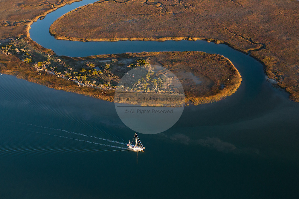 Aerial view of a sailboat passing through the intracoastal waterway in Charleston, SC