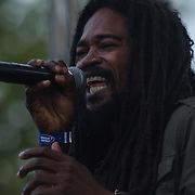 Junior Kava jah Johnson from the Reggae band i-KRONIK performs on stage during The 19th Annual Bob Marley People's Festival Saturday July 27, 2013, at Tubman-Garrett Riverfront Park in Wilmington Delaware.