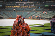 Fans huddle in ponchos during a rain delay on opening day at Oriole Park at Camden Yards in Baltimore, Monday, April 4, 2016.  The Baltimore Orioles defeated the Minnesota Twins 3-2.