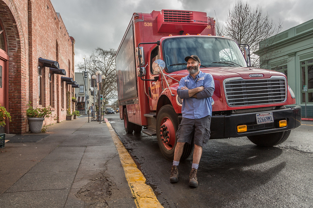 """""""I've been driving for Young's Market for eight years...I deliver wine, spirits and beer and cover an area of about 100 miles around Santa Rosa.""""   -Skip with his delivery truck outside the Hydro Grill in Calistoga"""
