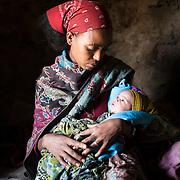 Bhafta Fisha, 20 and her 3 weeks old baby girl Kalayt Brhanu at home, Adi Sibhat, Tigray, Ethiopia