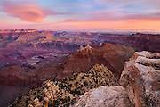 In the moments before sunrise the Grand Canyon begins to come to life. The many temples and buttes of the canyon reflect the warm morning light, and the clouds glow in hues of orange and yellow. The only sounds to be heard are the gentle whisper of the breeze and the faint roar of the distant Colorado River as it continues its work carving into the rock.<br />