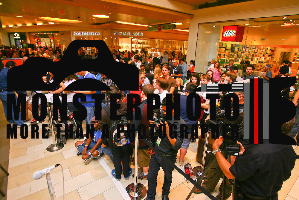 A crowd of people and press wait online for the New Microsoft store to open Saturday, Sept. 29 2012, at Christiana Mall in Newark DE..