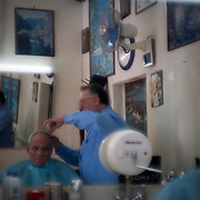 Dimitri, originally from Sydney, Australia moved to Athens in the early 50's where he opened this same Barber Shop. It is located inthe centre of Athens in an area called Gyzi. He now runs it with his son Lambros. Image © Angelos Giotopoulos/Falcon Photo Agency