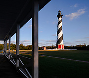 NC00676-00...NORTH CAROLINA - Cape Hatteras Lighthouse viewed from the porch of the Keepers House in Cape Hatteras National Seashore on the Outer Banks.