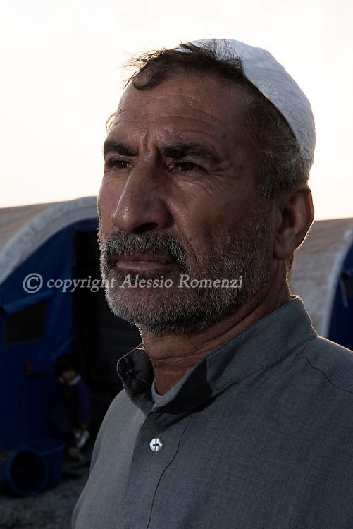 Iraq, Qayyara: Mahmood, displaced from Tob Zawa is portrait in Alkazik camp. Alessio Romenzi