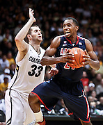 SHOT 1/21/12 6:44:02 PM - Arizona's Kyle Fogg #21 drives the lane in front of Colorado's Austin Dufault #33 during their PAC 12 regular season men's basketball game at the Coors Events Center in Boulder, Co. Colorado won the game 64-63..(Photo by Marc Piscotty / © 2012)