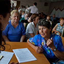 Miroslava Prymak, an attorney, helps Nadia Kalinchenko, among other clients, during a Òspecial consultationÓ for potential clients who are children of the Second World War, Rivne, Ukraine, June 15, 2011. This vulnerable group is made up of seniors, most of whom are not receiving proper compensation as promised by the government. The legal team advises them on how to properly fill out forms and submit them to the courthouse, while encouraging them not to give up on their rights. More than half of the worldÕs population, four billion people, live outside the rule of law, with no effective title to property, access to courts or redress for official abuse. The Open Society Justice Initiative is involved in building capacity and developing pilot programs through the use of community-based advocates and paralegals in Sierra Leone, Ukraine and Indonesia. The pilot programs, which combine education with grassroots tools to provide concrete solutions to instances of injustice, help give poor people some measure of control over their lives.