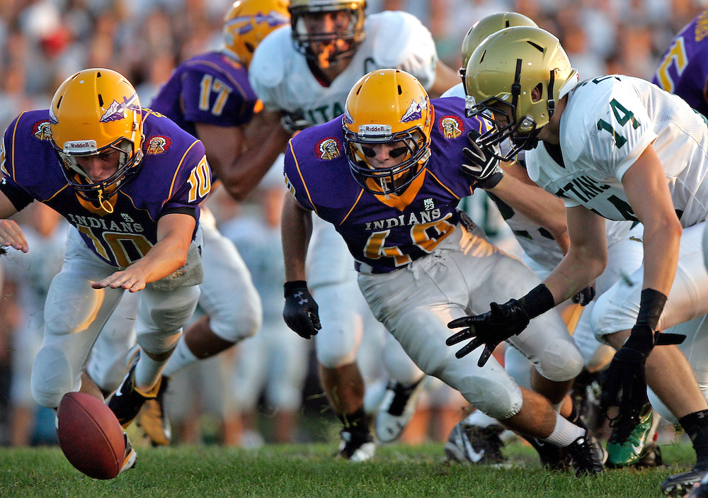 SCOTT MORGAN | ROCKFORD REGISTER STAR.Hononegah High School's Justin Studler (10), Eli Trulley (40) and Boylan's D.J. Zimmerman (14) chase after a fumble on the first snap of the first quarter Friday, Aug. 26, 2011, during their game at Hononegah in Rockton.