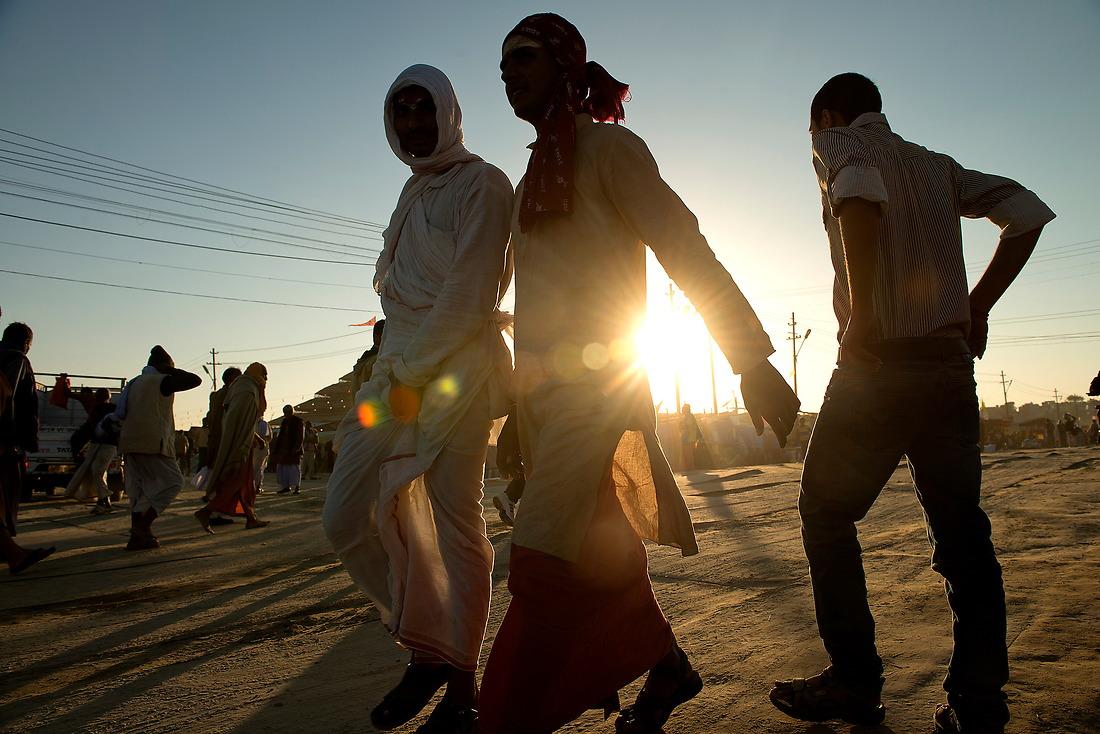 Hindu pilgrims walk the dirt roads through the camp area on February 7, 2013 in Allahabad, India during the Kumbh Mela. — © Jeremy Lock/