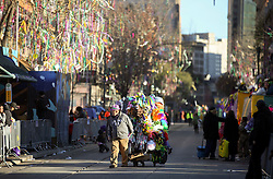 09 February 2016. New Orleans, Louisiana.<br /> Mardi Gras Day. Street vendors with their rigs loaded down with Mardi Gras trinkets make their way along St Charles Avenue in the early morning.<br /> Photo&copy;; Charlie Varley/varleypix.com