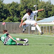 Goldey-Beacom Defender Carlos Bastardo (6) avoids a leg tackle by Wilmington University midfielder Ray Kuemmer (13) during a NCAA regular season match against Wilmington University Wednesday, Sept. 12, 2012. at Kirkwood Soccer Complex...Special to Monsterphoto/SAQUAN STIMPSON