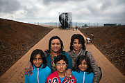 Back row Fiona Rangan, 46, and Jackie Naidoo, 52, both from Pietermaritzburg, pictured with Jadan, 9 (granddaughter of Jackie), Travis, 10 (son of Fiona), and Kaitlyn, 8 (granddaughter of Jackie), at the Nelson Mandela memorial in Howick, South Africa. It was here on 5 August 1962 that Nelson Mandela was captured by the police.