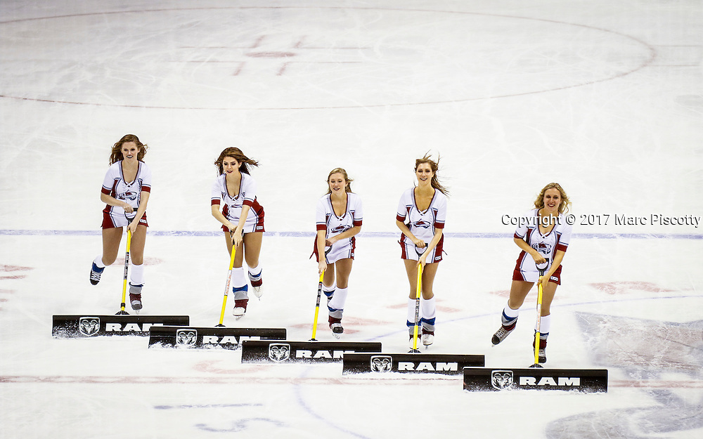 SHOT 2/25/17 10:19:51 PM - The Colorado Avalanche Ice Girls clear the snow off the ice during their NHL regular season game at the Pepsi Center in Denver, Co. The Avalanche won the game 5-3. (Photo by Marc Piscotty / © 2017)