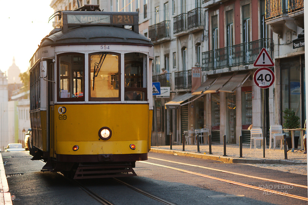 Lisbon's traditional yellow tram on the 28 line, passing at Calçada do Combro, the street that divides Bairro Alto and Bica neighborhoods.