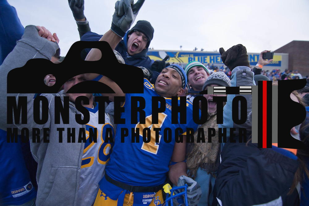 DB (#4) Anthony Bratton celebrates with the fans after No. 3 Delaware defeats Georgia Southern 27-10 on a cold Saturday afternoon at Delaware stadium in Newark Delaware...Delaware will head to Texas for the Division I FCS National Championship Game Vs Eastern Washington eagles who defeated Villanova 41-31 friday night in Washington..