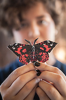 Student Karen Jamieson with a butterfly by origami artist Evan Sally at Calistoga High School.