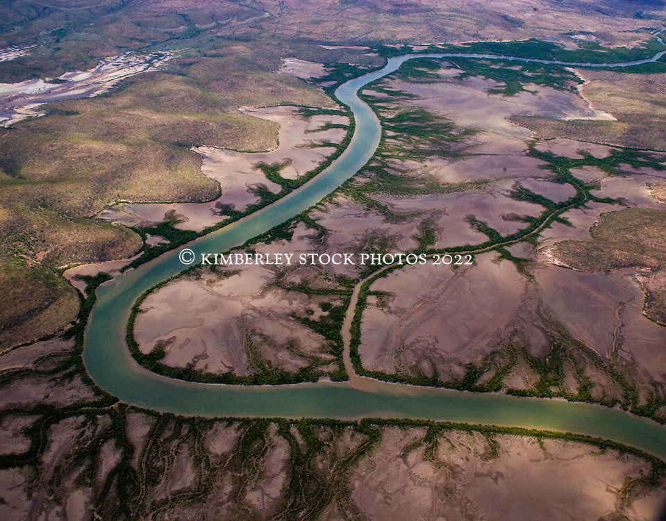 An aerial landscape view of a winding river near Cambridge Gulf on the east Kimberley coast .