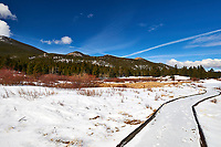 Winter trail and panorama at Lily Lake in Rocky Mountain National Park. Composite of five images taken with a Nikon D3 camera and 24-70 mm f/2.8 lens (ISO 200, 24 mm, f/16, 1/160 sec). Raw images processed with Capture One Pro and the composite generated using AutoPano Giga Pro. The jags in the contrails unfortunately show that the upper winds were strong while taking the five images.