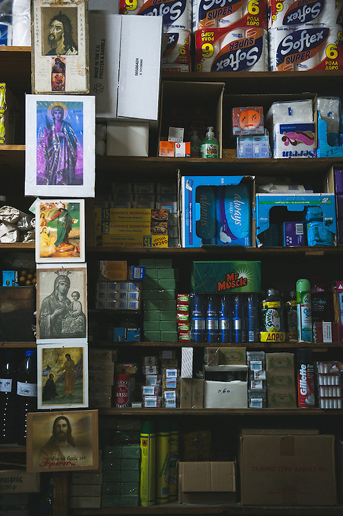The display of the products for sale together with religious icons in an old fashion traditional shop inside the castle of Chios.