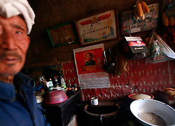 A picture made available on 06 November 2012 of 87-year-old farmer Chao in his cave home or 'yaodong' where a poster of former leader Mao Zedong is pasted on his wall in the rural outskirts of Yan'an city, Shaanxi Province China, 05 November 2012. The 'yadong' or cave dwellings are typical in the plateaus of northern China in Shaanxi Province where many of Yan'an's rural population still live in. They are mostly carved out from the yellow earth of the Loess hillsides and are about seven to eight metres deep with height and width of three metres. Former Communist leader Mao Zedong and his comrades are known to have hid in these cave homes during the civil war between the communists and nationalists in 1936 to 1948 as they battle the Kuomintang forces. Chao has lived in his cave home in the Loess mountains of Yan'an for more than 60 years, mostly in poverty and hardship as a farmer and was one of the few to have lived through the period of turmoil during the civil war. China's new leaders slated to take over during the 18th National Congress beginning on 08 November are likely to face mounting pressures to tackle the country's rising income inequalities between urban and rural areas that are often the source of simmering resentment and growing unrests on the grassroot level.