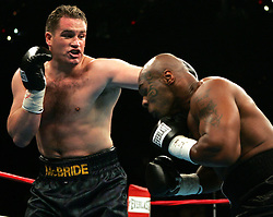 Mike Tyson (r) and Kevin McBride (l) trade punches during their 10 round heavyweight bout at the MCI Center in Washington, DC.  McBride won the fight via TKO when Tyson failed to answer the bell for the 7th round.
