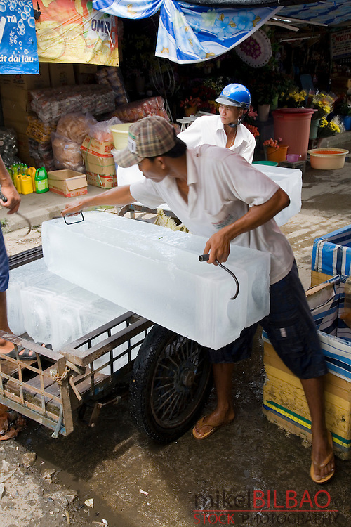ice block transport on a food street market. Can Tho city. Mekong river Delta, Vietnam, Asia