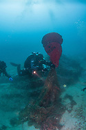 Global Underwater Explorers (GUE) diver using lift bag to raise ghost net to prevent further environmental destruction.
