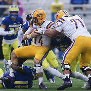 Albany quarterback DJ CROOK (14) is tackled for a lost during a week nine Colonial Athletic Association Conference game between the Delaware Blue Hens and the Albany Great Danes Saturday, Nov. 07, 2015 at Tubby Raymond Field at Delaware Stadium in Newark, DE.