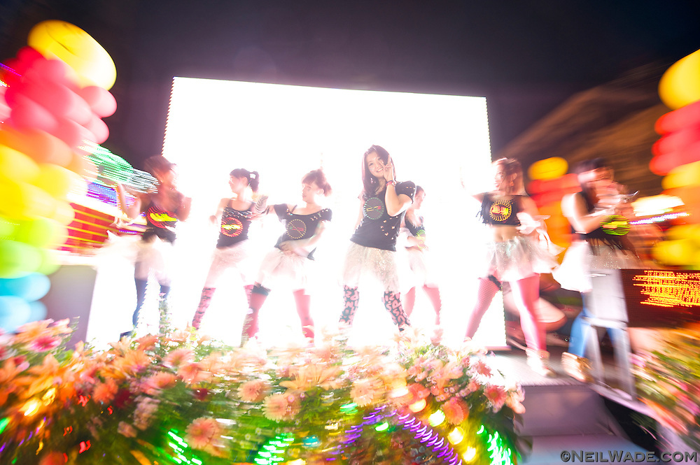 """Dancing girls promote """"No Smoking"""" at the 2011 Keelung Ghost Festival Parade."""