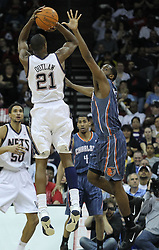 Apr 11; Newark, NJ, USA; New Jersey Nets small forward Travis Outlaw (21) hits a jump shot during the second half at the Prudential Center. The Bobcats defeated the Nets 105-103.
