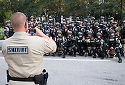 TAMPA, FL - August 30, 2012: Riot police gather for a group picture outside the Tampa Bay Time Forum during the 2012 Republican National Convention.