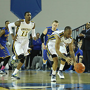Drexel Guard Chris Fouch (3) steals the ball in the second half of a NCAA regular season Colonial Athletic Association conference game between Delaware and Drexel Sunday, Feb 23, 2014 at The Bob Carpenter Sports Convocation Center in Newark Delaware.