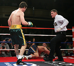 "Referee Wayne Kelly jumps in as ""Irish"" John Duddy knocks down Byron Mackie during their 10 round bout at Hammerstein Ballroom in NYC.  Duddy won the bout via 4th round KO to remain undefeated at 13-0, 12KO's."
