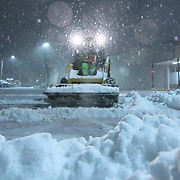 A bobcat removing snow from the parking lot as snow falls Friday, Jan, 22, 2016 at Newark Shopping Center in Newark.<br /> <br /> A massive blizzard dumps snow in Newark, and eastern United States on Friday, with mass flight cancellations, five states declaring states of emergency.