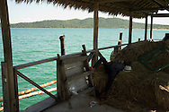 A man sleeps in a port in Koh Rong Island, Kingdom of Cambodia. PHOTO TIAGO MIRANDA