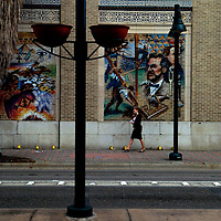 ORLANDO, FL -- January 30, 2008 -- A woman talks on her cell while walking amongst the large murals along Magnolia Ave. in downtown Orlando, Fla., on Friday, January 27, 2006.