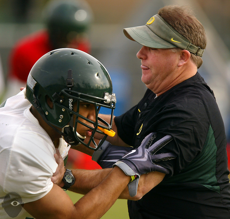 12//28/09  - Oregon Duck's head coach Chip Kelly plays a little offense with Talmadge Jackson III (37) during practice at the Home Depot Center on Monday morning.