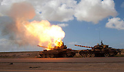A Burning tank  of Qaddai's army burning that were hit by coalition forces on the road from Benghazi to Ajhtabiya Libya Mrch 20,2011. (Photo by Heidi Levine/Sipa Press~)