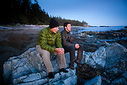 Henry Pedersen (left) and Zach Podell-Eberhardt watch the sunset from a beach on the West Coast Trail, British Columbia, Canada.