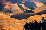 tourists admiring the brilliant sunset of Grand Canyon