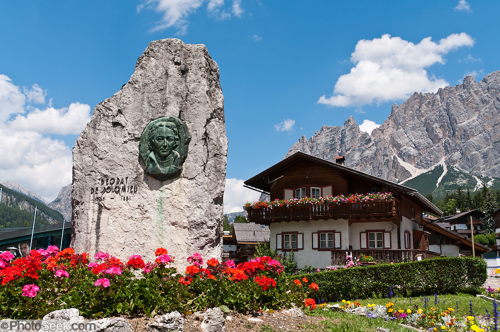 """The Dolomite mineral and mountains were named after French geologist Déodat de Dolomieu (1750-1801, also known as Dieudonné Sylvain Guy Tancrède de Dolomieu). The mountain town of Cortina d'Ampezzo (Ladin: Anpëz, German: Hayden, at 1224 meters / 4016 feet elevation) is surrounded by the Dolomites (Dolomiti, a part of the Southern Limestone Alps) at the top of Valle del Boite in the Province of Belluno, Veneto region, northern Italy. This ski resort hosted the 1956 Winter Olympics and motion pictures including: """"The Pink Panther"""" (1963), """"For Your Eyes Only"""" (1981, James Bond stunt sequences); and """"Cliffhanger"""" (1993). Nearby peaks include the highest summit, Tofana di Mezzo (3244 m / 10,643 feet) in Tofane mountain group to the west, Pomagagnon to the north, Cristallo to the northeast, Faloria and Sorapiss to the east, and Becco di Mezzodì, Croda da Lago and Cinque Torri to south. The Dolomites were declared a natural World Heritage Site (2009) by UNESCO."""
